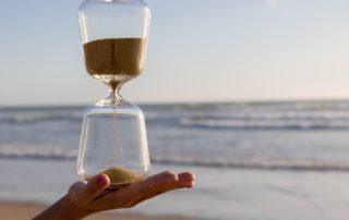 Hourglass on beach